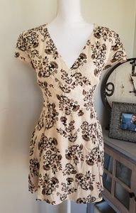Cream romper with floral print